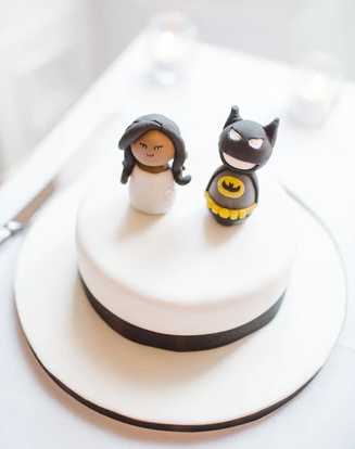 figures on a wedding cake by Tom the Photographer on Unsplash