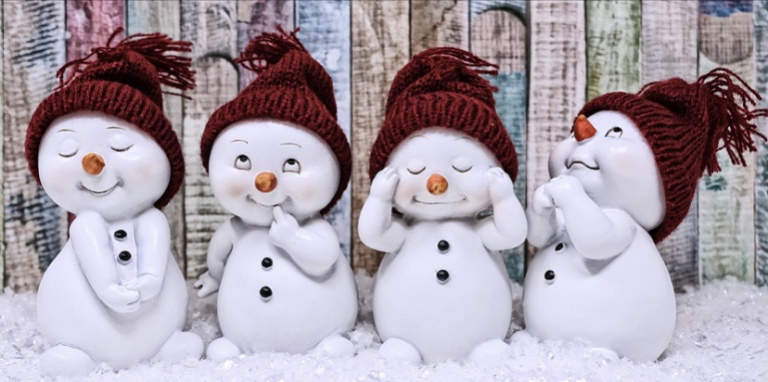 The image shows four tiny snow men like figures in different poses. All looking very cute!